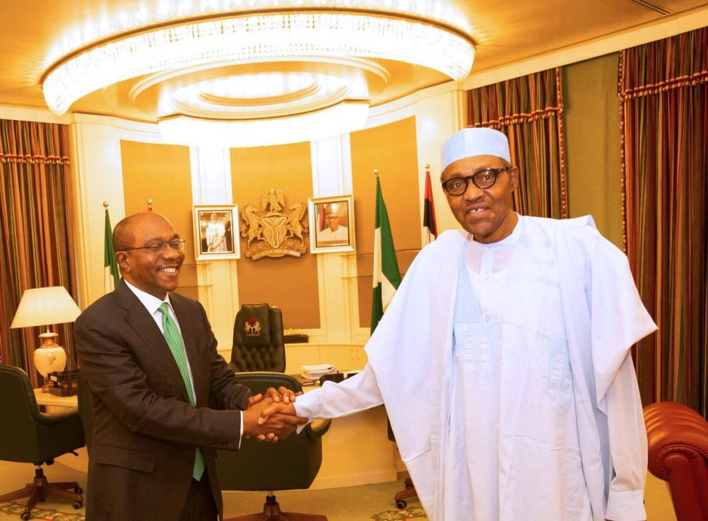 Buhari-receives-and-congratulates-the-Central-Bank-Governor-of-Nigeria-Mr.-Godwin-Emefiele-in-his-office-State-House-Abuja